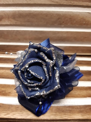 navy glittered rose with navy and silver detail wrist corsage