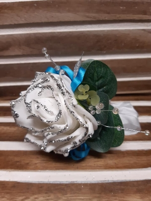 White glittered rose with turquoise detail wrist corsage