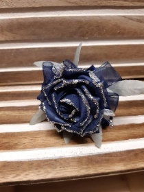 Navy glittered rose with navy detail wrist corsage