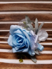Pale blue rose with white detail wrist corsage