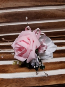 Pale pink rose with white detail wrist corsage