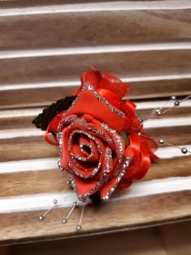 red glittered rose with red detail wrist corsage