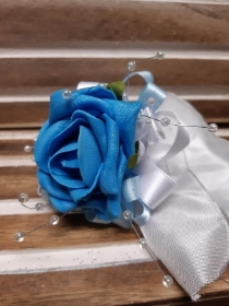 turquoise blue rose with pale blue and white detail wrist corsage