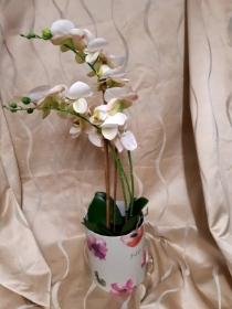 White artificial Phaelenopsis orchid