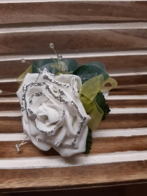white glittered rose with acid lemon detail wrist corsage