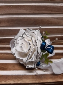 White glittered rose with teal detail wrist corsage